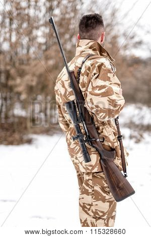Portrait Of Military Army Man Carrying A Sniper Rifle, For Battlefield Operations