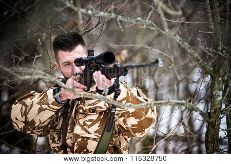 Hunting, Army, Military Concept - Sniper Holding Rifle And Aiming At Target In The Forest During Ope