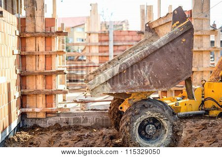 Dumper Truck Unloading Gravel, Sand And Stones At Construction Site. Bricklayering And Working