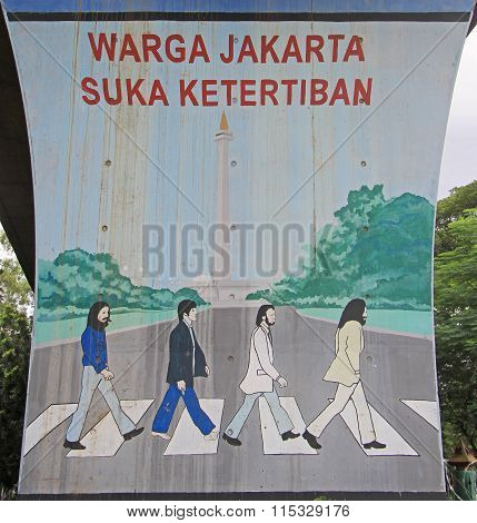 graffiti with reference to cover of Beatles album 'Abbey Road' in Jakarta