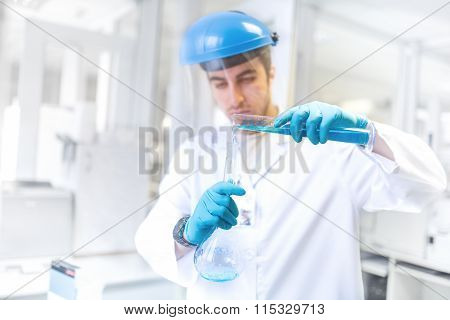Scientist Doctor Using Laboratory Flask For Taking Samples From Test Tube And Comparing Results