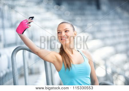 Beautiful Girl Taking Selfies While Training. Fitness Concept With Smartphone, Girl And Workout
