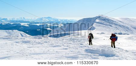 Hiking on a snowy ridge