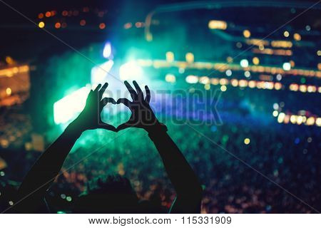 Heart Shaped Hands At Concert, Loving The Artist And The Festival. Music Concert With Lights