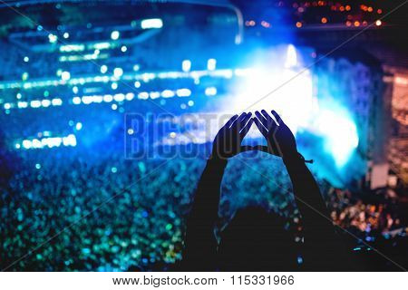 Man Showing Love At Concert, Silhouette Of Hands Making Gestures With Lights Background