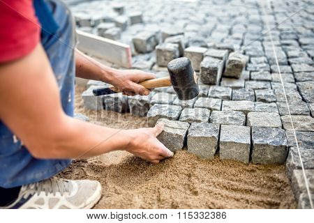 Construction Worker Installing Stone Blocks On Pavement, Street Or Sidewalk Construction Works