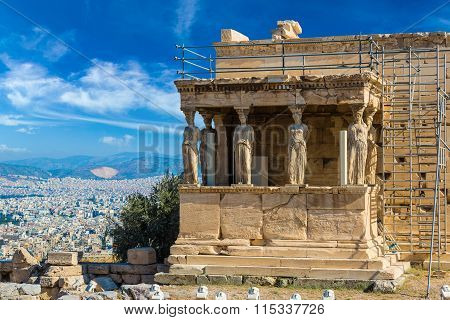 Caryatids Erechtheum temple ruins on the Acropolis in a summer day in Athens Greece poster