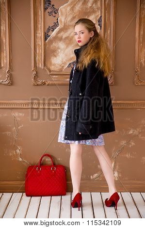 The Girl In A Coat With A Red Bag