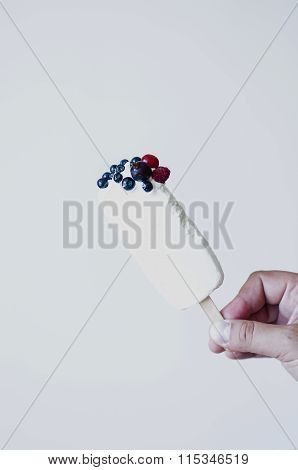 Ice lolly topped with fresh berries