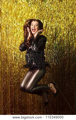 Beautiful Cheerful Woman Jumping On Sparkling Background. Party.