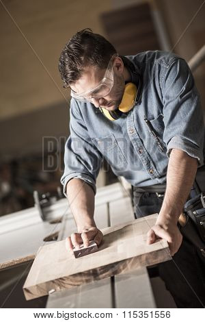 Joinery Man Polishing Up Wood