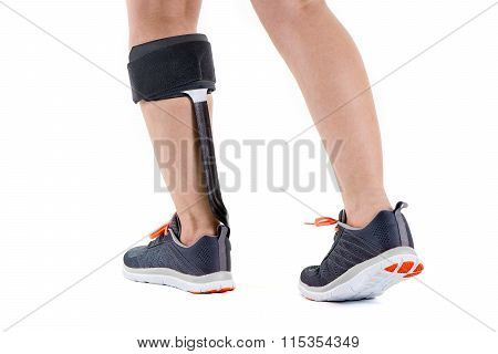 Person In Athletic Sneakers Wearing Brace On Calf