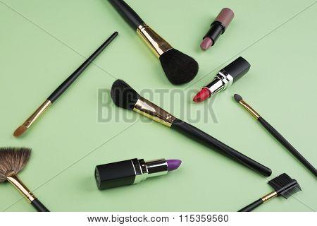 Set of make-up brushes and eye shadows