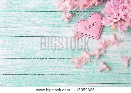 Decorative Heart  And  Hyacinths Flowers  On Turquiose Painted Wooden Planks.