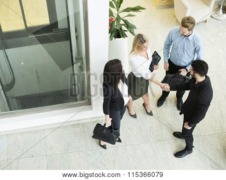 Young people shaking hands in the office