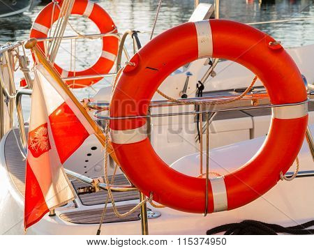 Lifebuoy On Sailboat And Polish Ensign