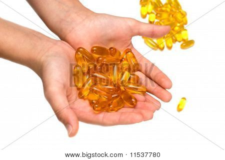 Isolated Pill Gel Supplement Capsules On Hand, Macro