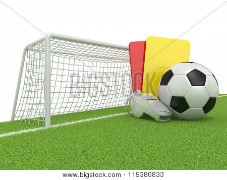 Football concept. Penalty (red and yellow) card metal whistle and soccer (football) ball and gate