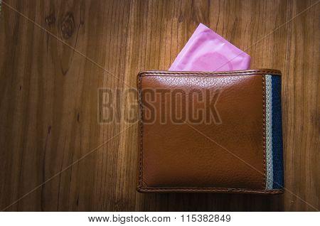 Condom In Man Wallet