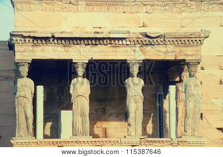 Detail of Erechtheion ancient Greek temple on the Acropolis. Silhouette of ancient caryatides statue. Vintage color tone background. Athens Greece. poster