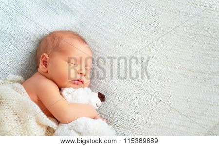 Cute Newborn Baby Sleeps With Toy Teddy Bear