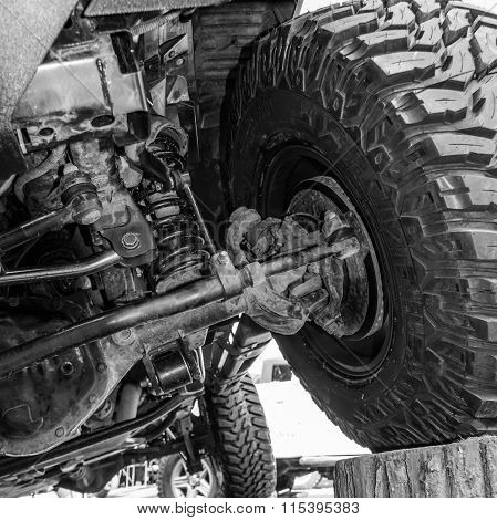 Black And White View From Under A Car. Close-up View Of A Car's Underside..