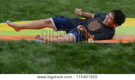 Slip and Slide with Water Balloons