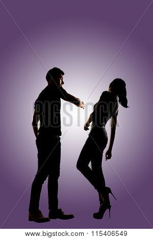 Silhouette of a man slapping a woman depicting domestic violence, full length isolated.