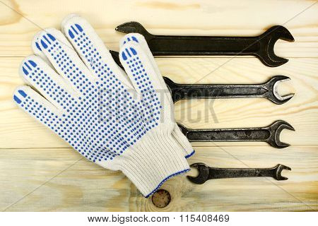 Open-end Wrenches And Protective Gloves