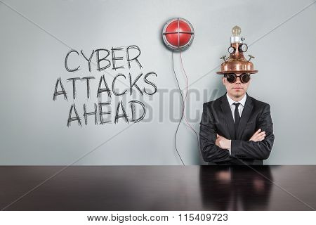 Cyber attacks ahead text with alert light and vintage businessman