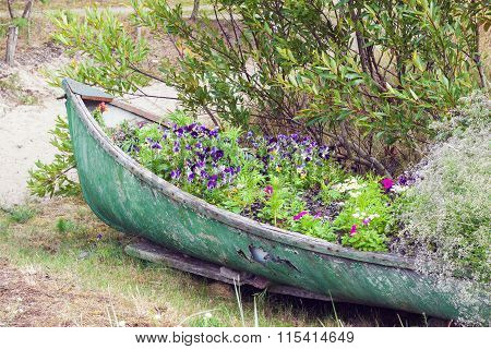 Abandoned Boat Decorated With Flowers