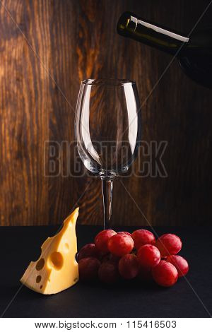 Glass For Wine, A Pice Of Cheese And Bunch Of Grapes