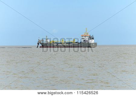 dredger out at sea