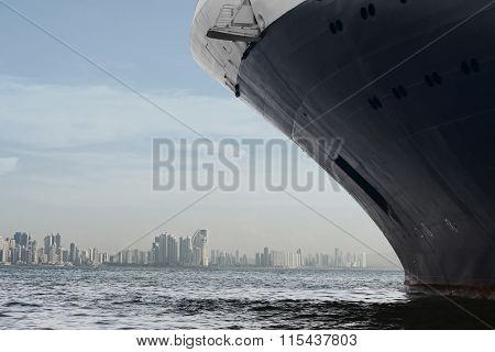 Panama city skyline. Large cruise ship entering panama city.
