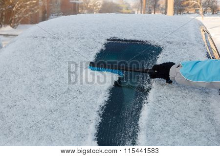 Clearing snow off a car