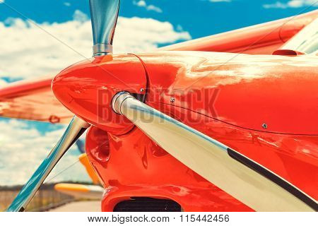 Propeller of a red airplane at the airport