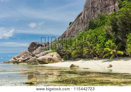 Beautifully shaped granite boulders and a perfect white sand at Anse Pierrot beach, La Digue island, Seychelles poster