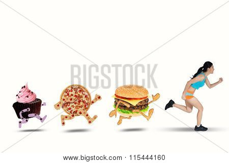 Woman Running Away From Junk Food