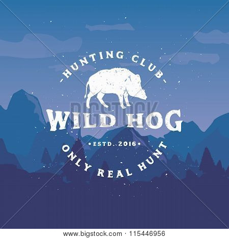 Vintage Hunting Club Emblem with Wild Hog on mountains background.