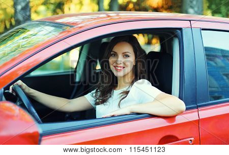 Happy Smiling Woman Driver Behind The Wheel Red Car