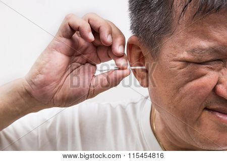 Man Cleaning Ear With Cotton Buds Stick With Ticklish Expression