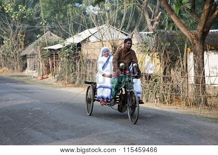 SUNDARBANS, INDIA - JANUARY 14: Sisters of Missionaries of Charity of Mother Teresa by rickshaw visit patients in the Sundarbans area of the jungle, on January 14, 2009 in West Bengal, India.