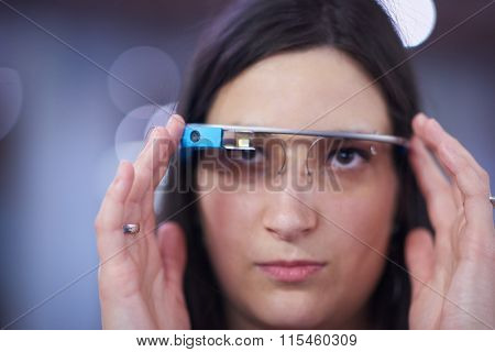 young woman using virtual reality gadget computer technology glasses poster