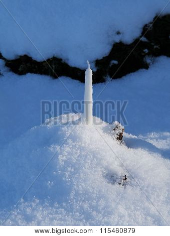 candle on the graveyard in the snow