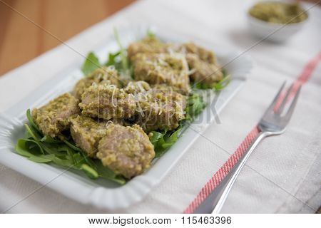 Home made potato gnocchi with fresh pesto