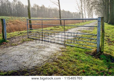 Half Opened Galvanized Steel Gate In A Rural Landscape