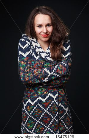 Attractive Brunette Girl In Colored Knit Sweater Shrank From The Cold.