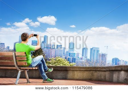 Man take selfie and Seattle downtown view