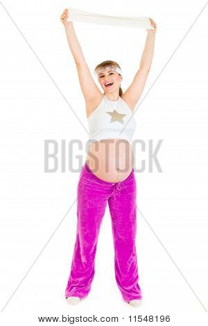 Happy beautiful pregnant woman enjoying making sports isolated on white