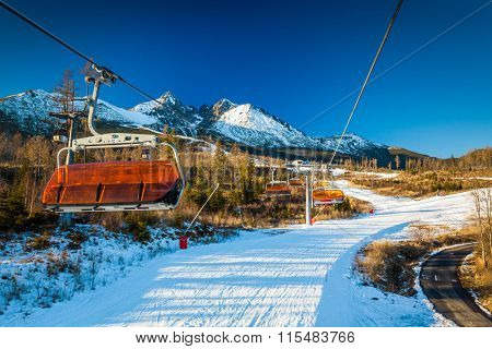 TATRANSKA LOMNICA, SLOVAKIA, 23 DEC 2015: Cable car at a popular ski resort in Tatranska Lomnica, High Tatras, with 6 km long dowhnill track.